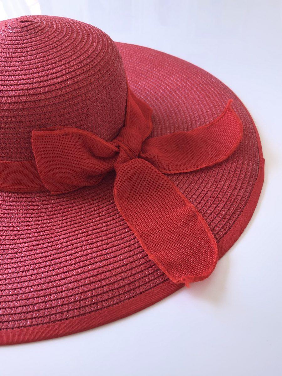 Large brimmed red hat