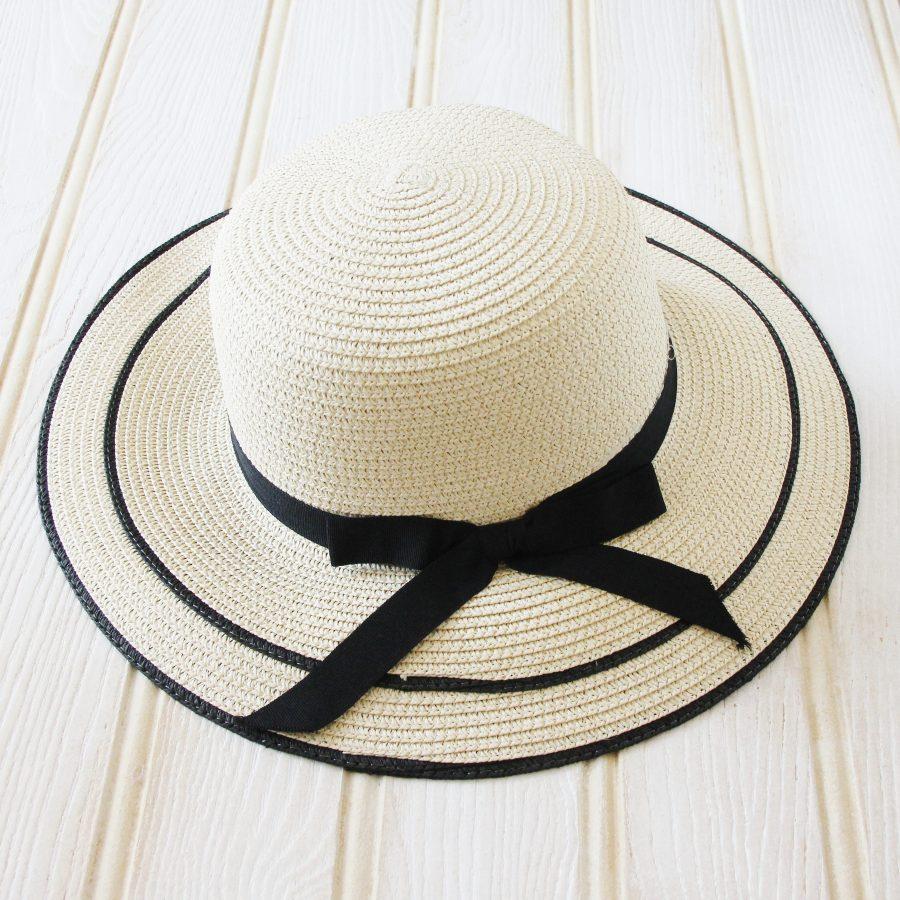 Elegant hat with black ribbon